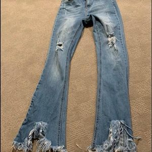 Jeans with shredded detail